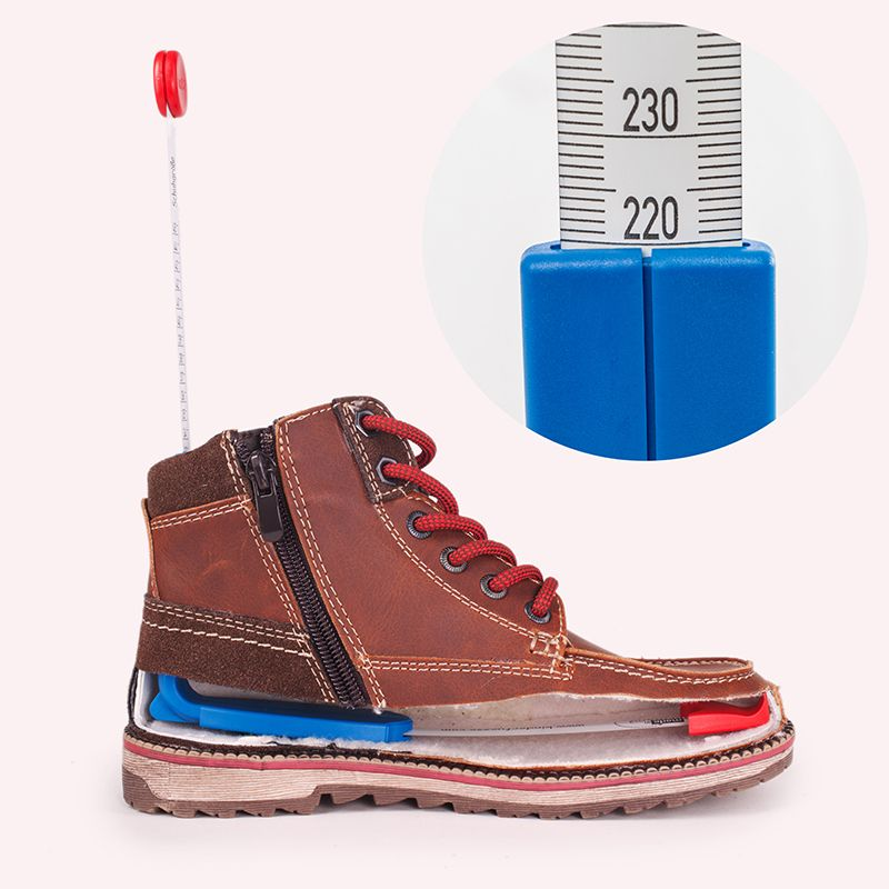 Picture of the plus12 measuring device for feet and shoes with a shoe